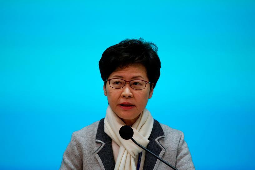 HK leader declares virus emergency, halts official visits to mainland China