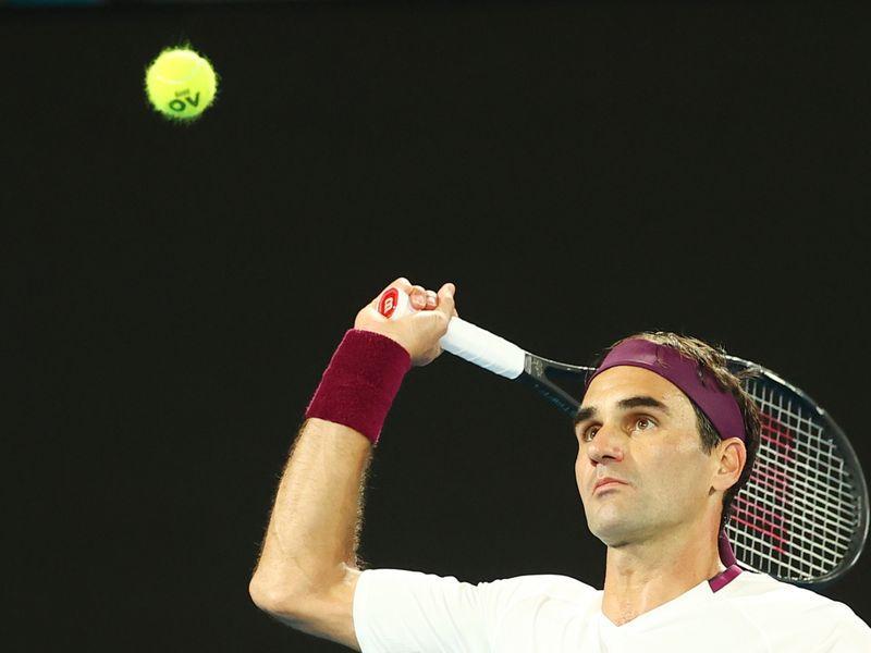 Federer shifts gear after slow start to reach Melbourne quarters