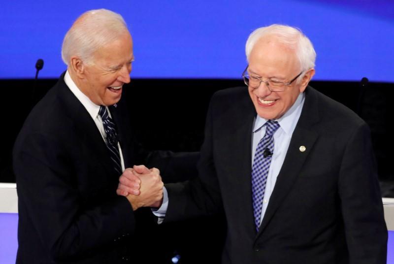 U.S. presidential hopefuls Sanders, Biden in tight race in early primary states