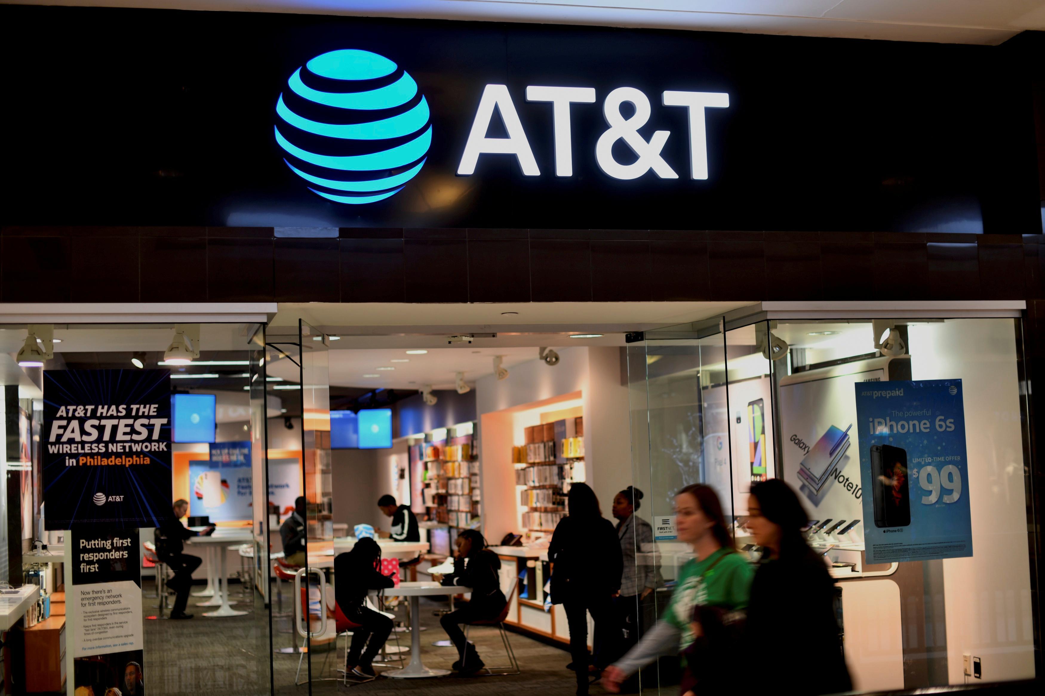 AT&T revenue falls short of estimates as satellite TV sheds...