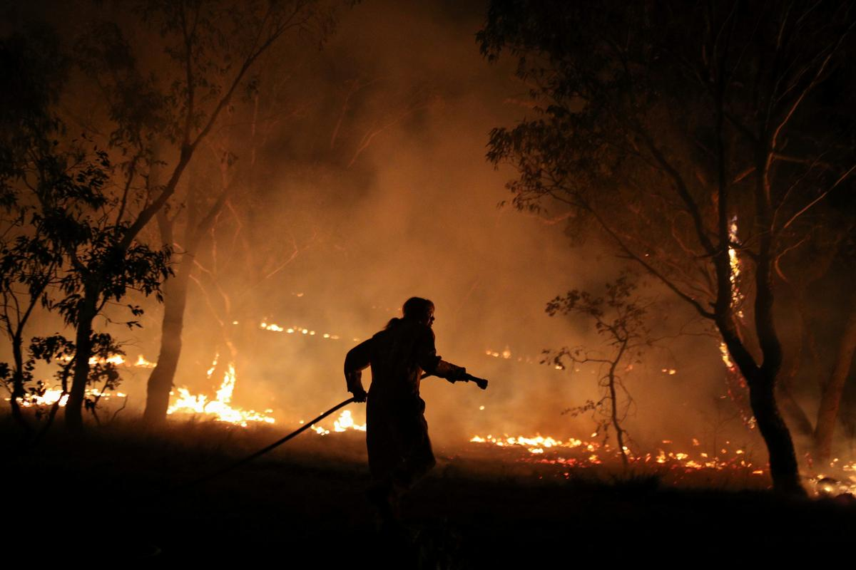 Australia's capital lifts state of emergency as fire threat subsides