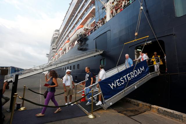 Passengers leave of MS Westerdam, a cruise ship that spent two weeks at sea after being turned away by five countries over fears that someone aboard might have the coronavirus, as it docks in Sihanoukville, Cambodia February 14, 2020.  REUTERS/Stringer