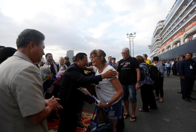 Cambodia's Prime Minister Hun Sen welcomes passenger of MS Westerdam, a cruise ship that spent two weeks at sea after being turned away by five countries over fears that someone aboard might have the coronavirus, as it docks in Sihanoukville, Cambodia February 14, 2020. REUTERS/Stringer