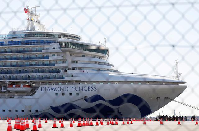 FILE PHOTO: The cruise ship Diamond Princess, where dozens of passengers were tested positive for coronavirus, is seen through steel fence at Daikoku Pier Cruise Terminal in Yokohama, south of Tokyo, Japan, February 11, 2020. REUTERS/Issei Kato/File Photo