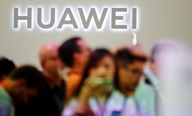 FILE PHOTO: The Huawei logo is pictured at the IFA consumer tech fair in Berlin, Germany, September 6, 2019. REUTERS/Hannibal Hanschke/File Photo