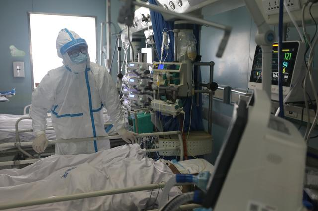 A medical worker is seen at the intensive care unit (ICU) of Jinyintan hospital in Wuhan, the epicentre of the novel coronavirus outbreak, in Hubei province, China February 13, 2020. China Daily via REUTERS