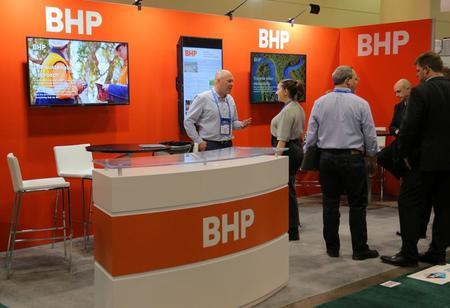 UPDATE 2-Iron ore prices boosts BHP half-year profit, sees limited coronavirus impact