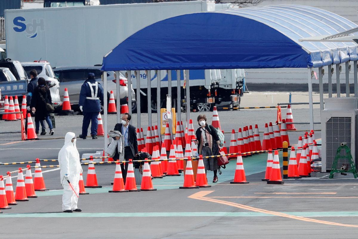 With stricken cruise ship, Japan draws criticism over coronavirus response
