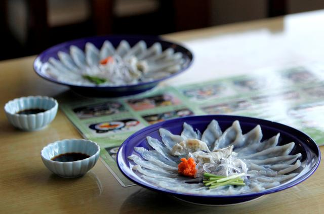 FILE PHOTO: Thinly sliced pufferfish sashimi is served at a restaurant in Shimonoseki, Japan February 7, 2020. Picture taken on February 7, 2020. REUTERS/Sakura Murakam