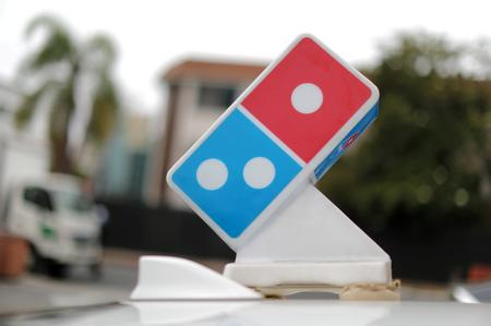UPDATE 1-Domino's U.S. same-store sales, profit beat estimates, shares jump 20%