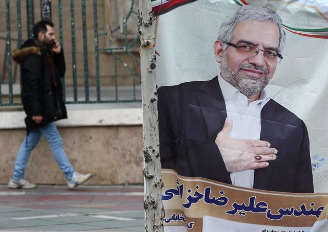 A banner of a parliamentary candidate is seen in Tehran, Iran February 19, 2020.  WANA (West Asia News Agency)/Nazanin Tabatabaee via REUTERS