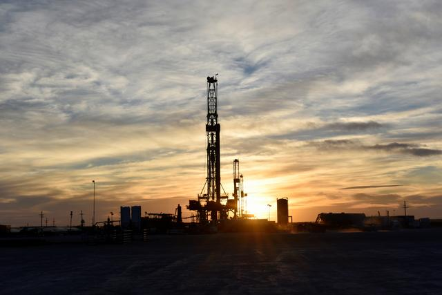 FILE PHOTO: Drilling rigs operate at sunset in Midland, Texas, U.S., February 13, 2019.REUTERS/Nick Oxford/File Photo