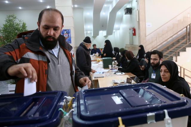 A man casts his vote during parliamentary elections at a polling station in Tehran, Iran February 21, 2020. Nazanin Tabatabaee/WANA (West Asia News Agency) via REUTERS
