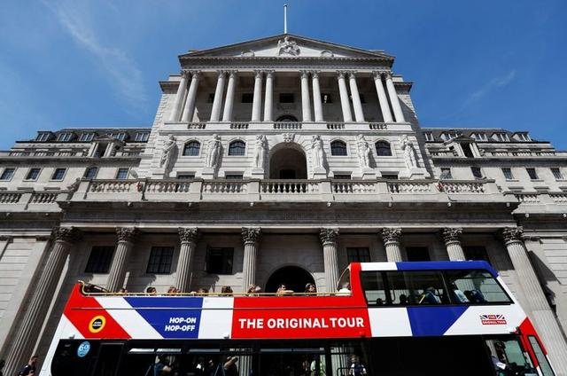 A tour bus passes the Bank of England in London Britain August-1-2018.