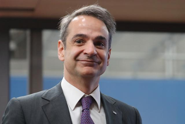 Greece's Prime Minister Kyriakos Mitsotakis arrives for the second day of the European Union leaders summit, held to discuss the EU's long-term budget for 2021-2027, in Brussels, Belgium, February 21, 2020. Ludovic Marin/Pool via REUTERS
