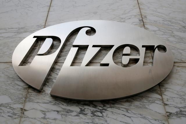 FILE PHOTO: The Pfizer logo is seen at their world headquarters in Manhattan, New York, U.S., August 1, 2016.  REUTERS/Andrew Kelly