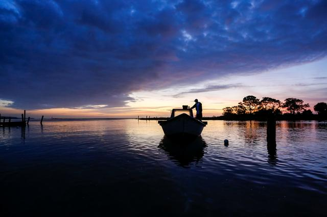 Frankie Crosby of Eastpoint, Florida, U.S., prepares his boat for a day of work harvesting oysters from Apalachicola Bay February 11, 2020.REUTERS/Colin Hackley