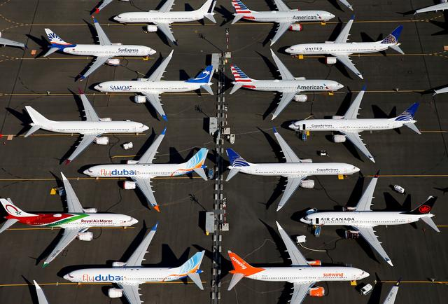 FILE PHOTO: Grounded Boeing 737 MAX aircraft are seen parked in an aerial photo at Boeing Field in Seattle, Washington, U.S. July 1, 2019.   REUTERS/Lindsey Wasson/File Photo