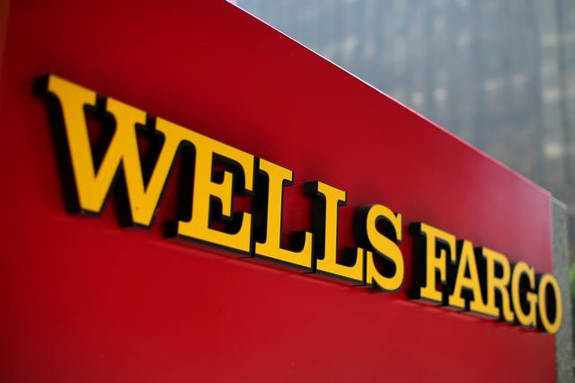 FILE PHOTO: A Wells Fargo bank sign is pictured in downtown Los Angeles, California, U.S. August 10, 2017. REUTERS/Mike Blake