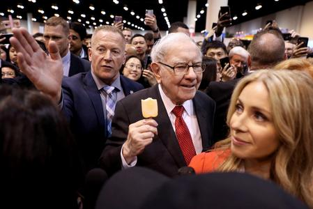 WRAPUP 4-Buffett defends Berkshire stock push, reassures on future as profit smashes record