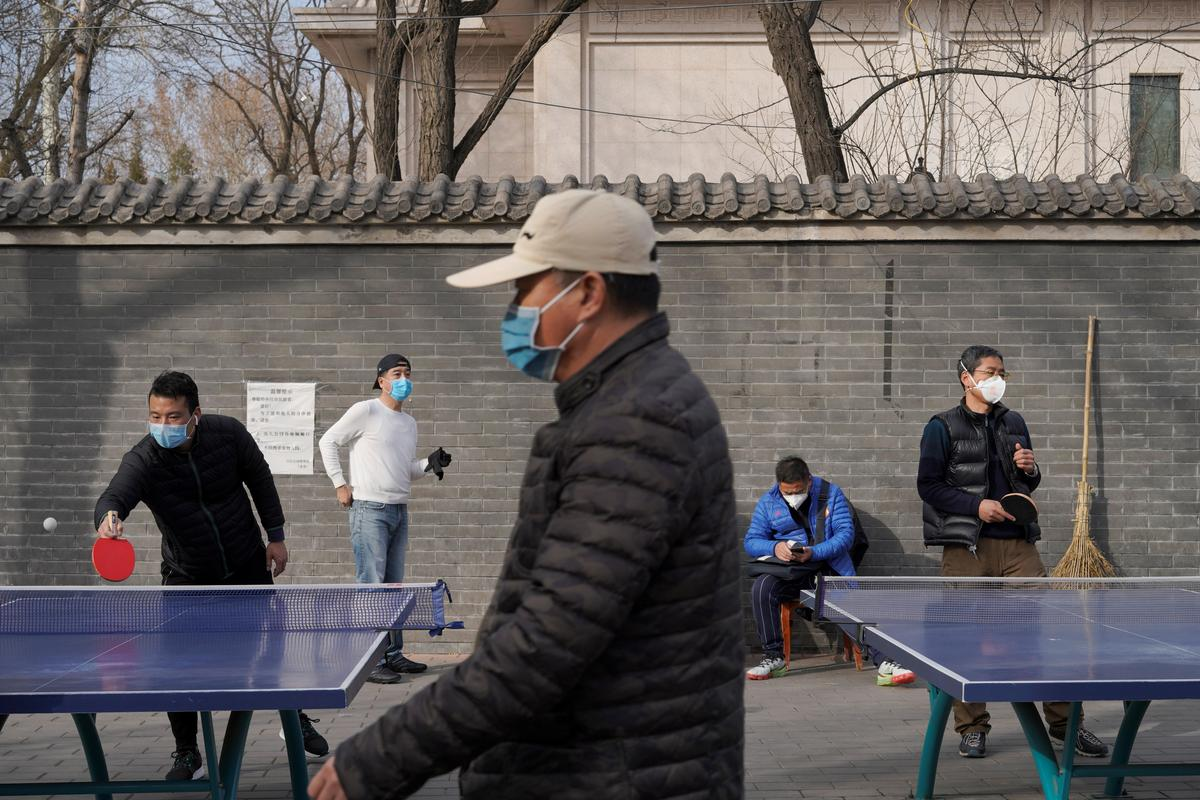 New coronavirus cases fall in China, but WHO concerned by global spread