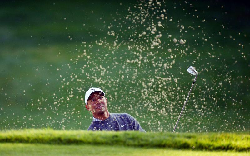 Woods' back still stiff, will skip Palmer Invitational: agent
