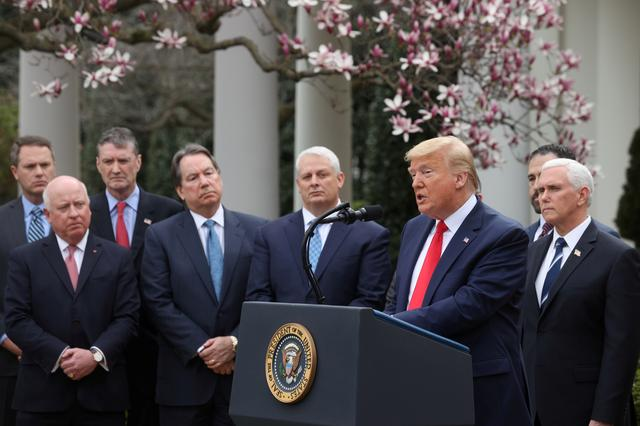FILE PHOTO: U.S. President Donald Trump is accompanied by Vice President Mike Pence and industry executives during news conference where the president declared the coronavirus pandemic a national emergency in the Rose Garden of the White House in Washington, U.S., March 13, 2020. REUTERS/Jonathan Ernst