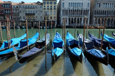 Clear water flows through Venice canals