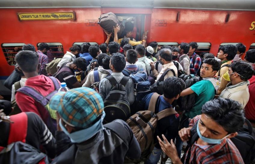 Poor Indians flee to villages as coronavirus measures take heavy ...