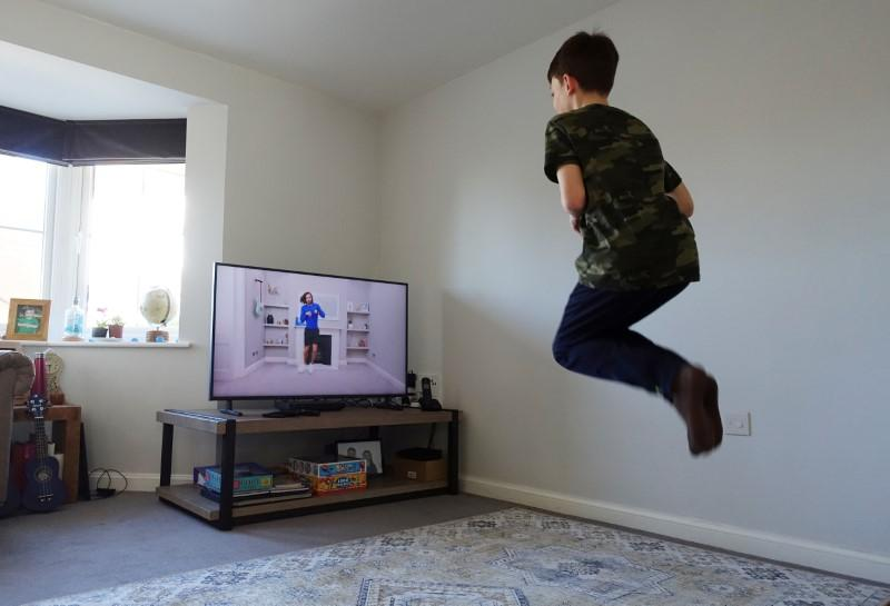 Physical education online: British children join exercise lesson from home