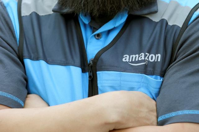 Danny Gonzalez makes deliveries for Amazon during the outbreak of the coronavirus disease (COVID-19) in Anaheim, California, U.S., March 23, 2020.      REUTERS/Alex Gallardo