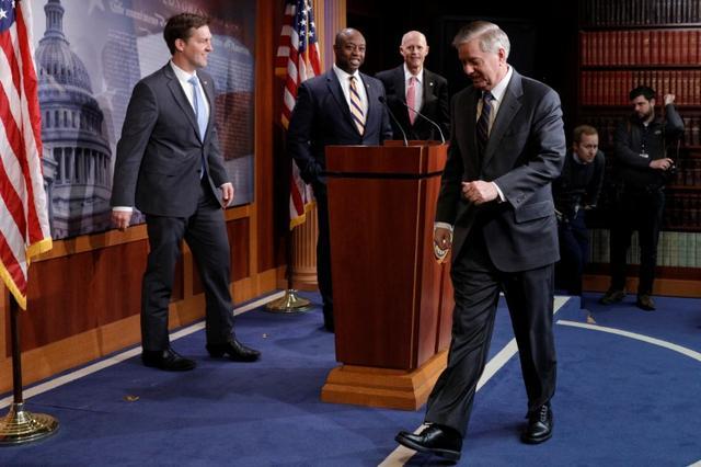 Senators Ben Sasse (R-NE), Tim Scott (R-SC), Rick Scott (R-FL), and Lidnsey Graham (R-SC) walk onstage ahead of a news conference on the coronavirus relief bill, on Capitol Hill in Washington, U.S., March 25, 2020. REUTERS/Tom Brenner