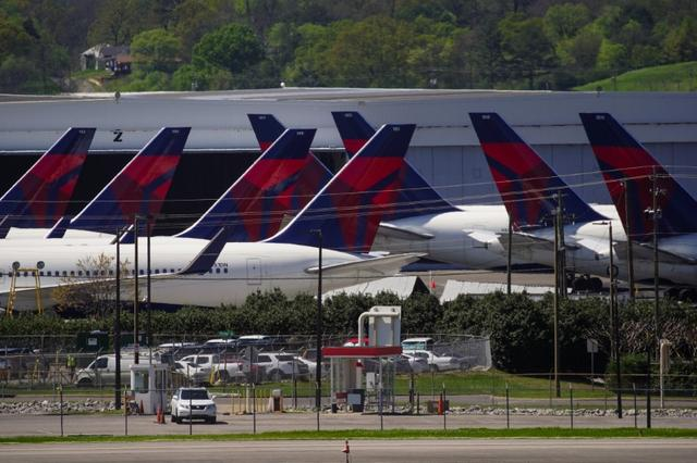 Delta Air Lines passenger planes are seen parked due to flight reductions made to slow the spread of coronavirus disease (COVID-19), at Birmingham-Shuttlesworth International Airport in Birmingham, Alabama, U.S. March 25, 2020.  REUTERS/Elijah Nouvelage