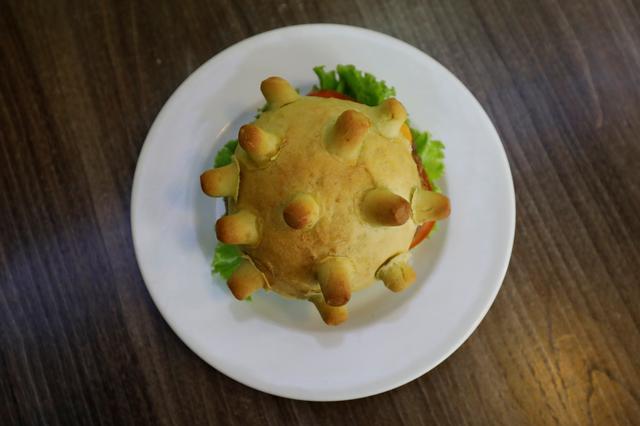 A burger shaped as coronavirus is seen at a restaurant in Hanoi, Vietnam March 25, 2020. REUTERS/Kham