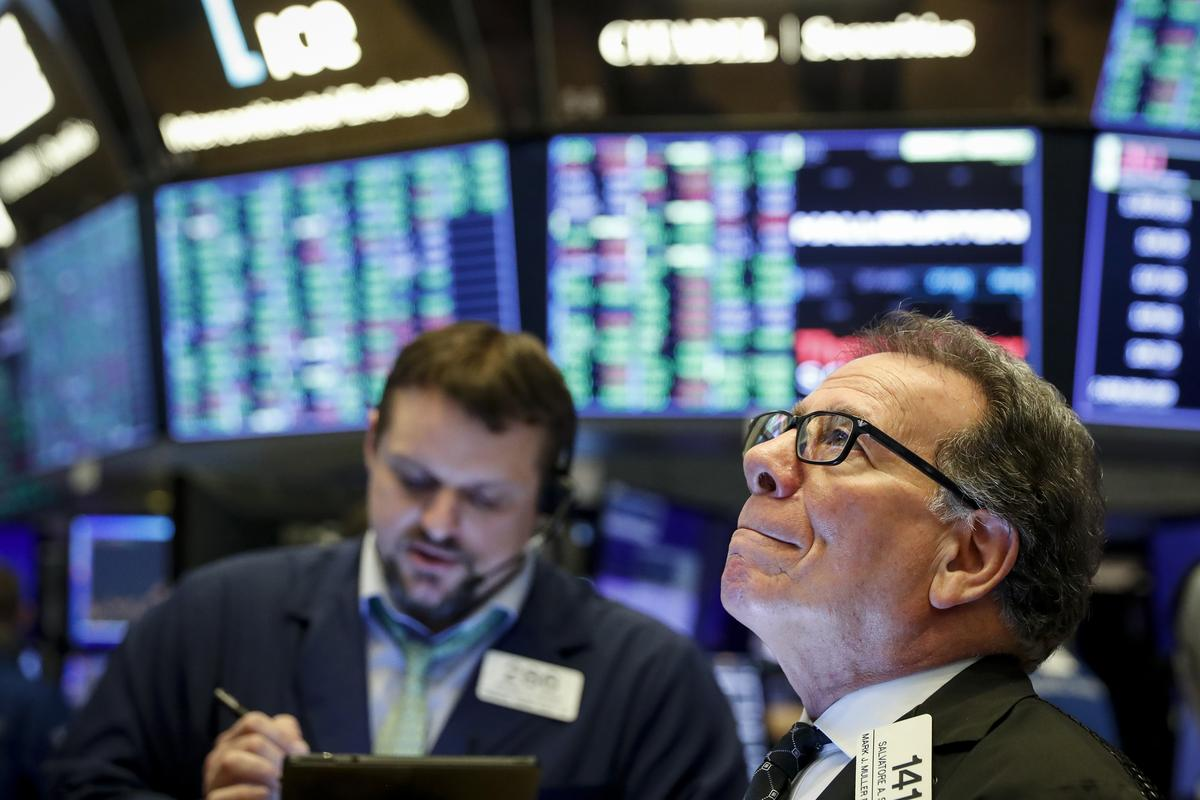 Wall St. rallies for third day as investors focus on stimulus