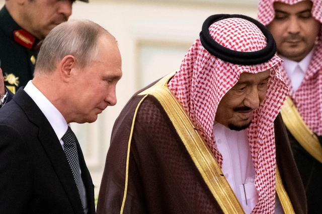 FILE PHOTO: Russian President Vladimir Putin and Saudi Arabia's King Salman attend a welcome ceremony in Riyadh, Saudi Arabia, October 14, 2019. Alexander Zemlianichenko/Pool via REUTERS/