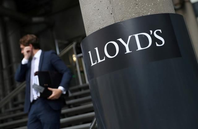 FILE PHOTO: A man walks out of Lloyds of London's headquarters in the City of London, Britain, July 31, 2018. REUTERS/Simon Dawson/File Photo
