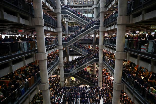 FILE PHOTO: Staff members stand for a poppy drop during a Remembrance Service at the Lloyd's building in the City of London, Britain November 8, 2019. REUTERS/Hannah McKay/File Photo