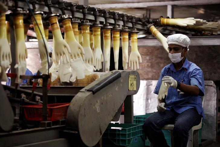 World's largest glove maker sees shortage as coronavirus fight spikes