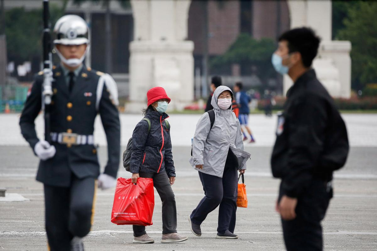 In Taiwan, anger at China over virus drives identity debate