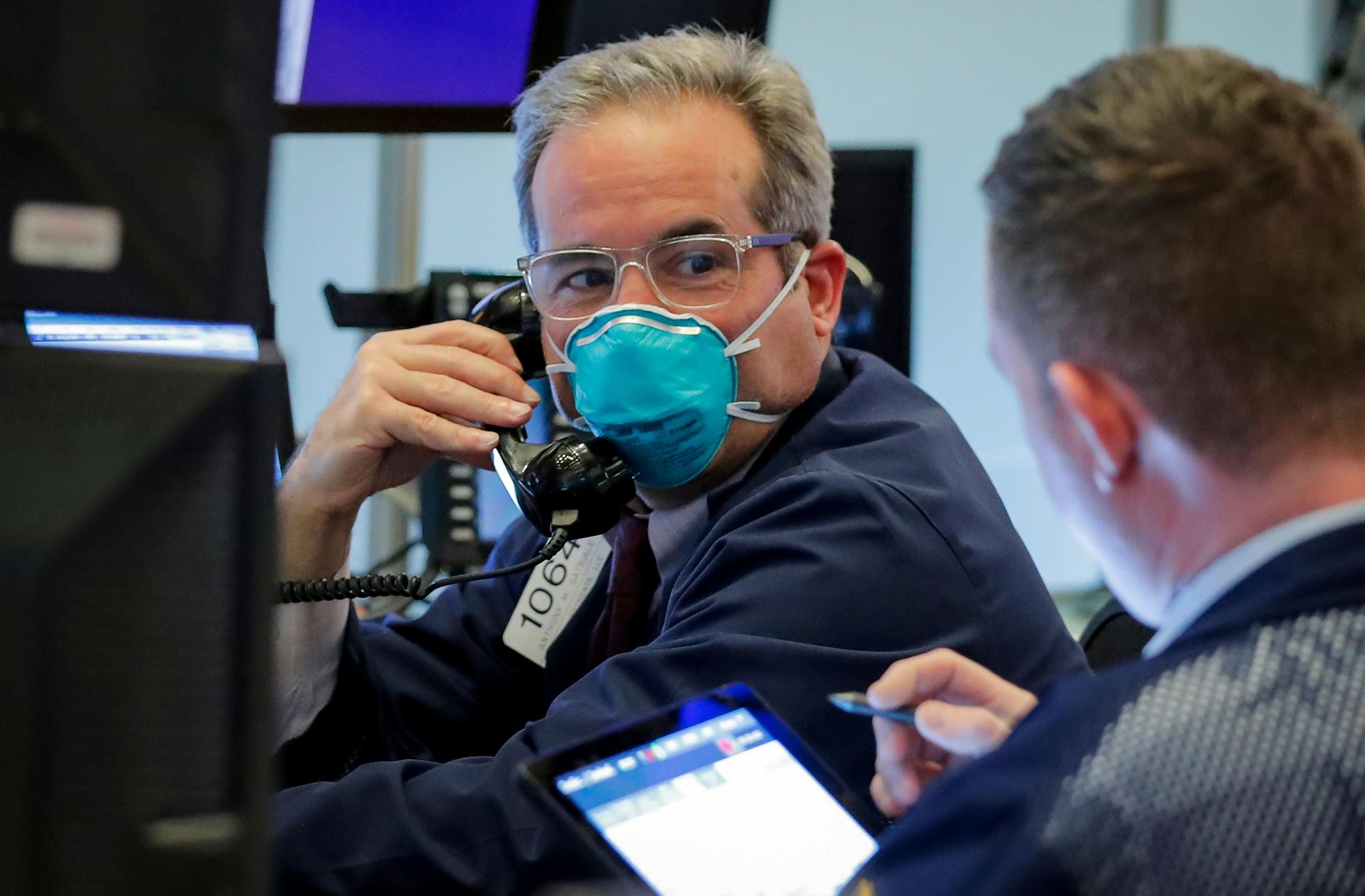 Wall Street sinks as coronavirus anxiety grows