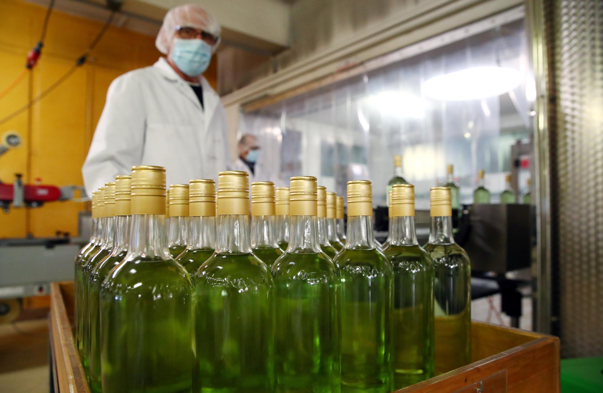 Swiss distillery shifts from schnapps to sanitizer