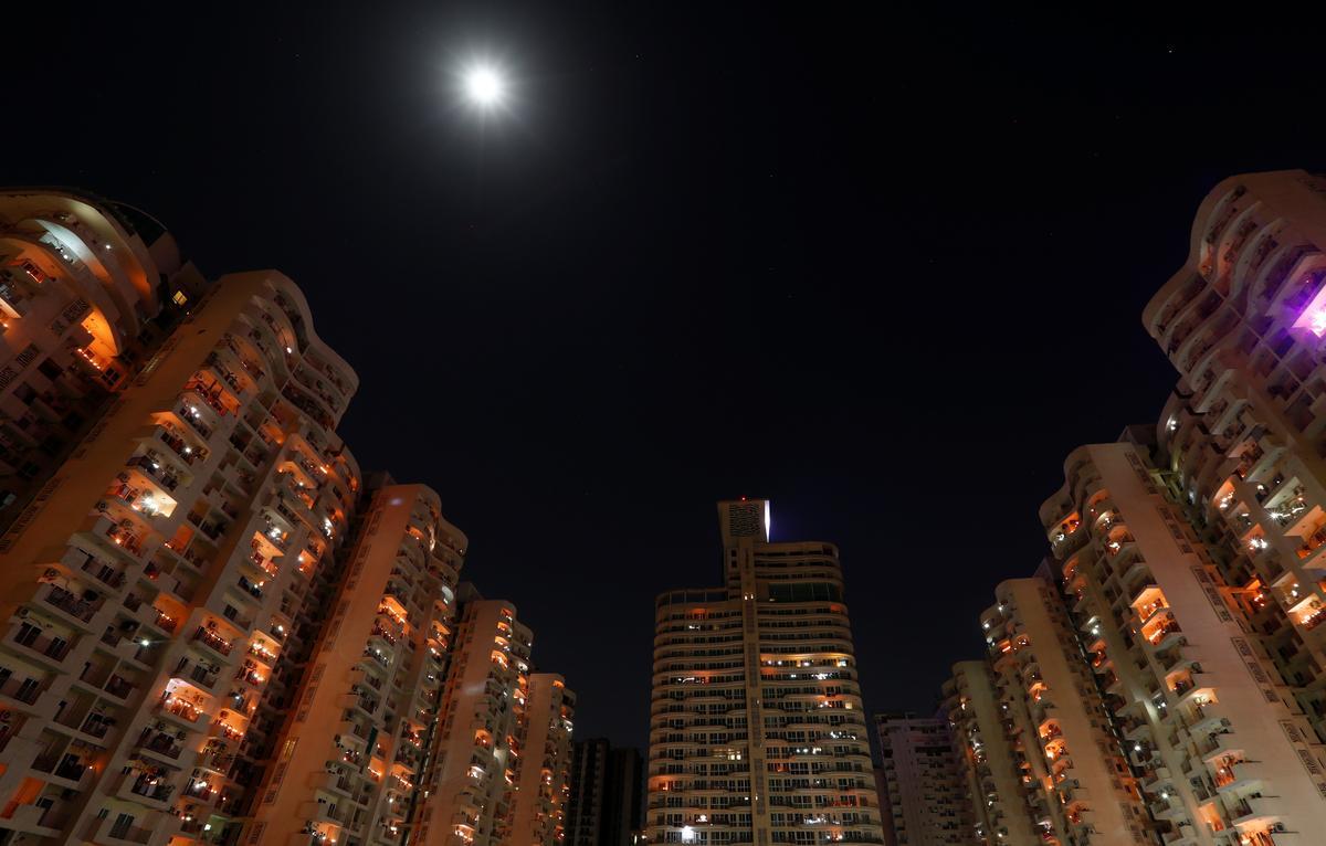 Indians light lamps to challenge darkness of coronavirus crisis