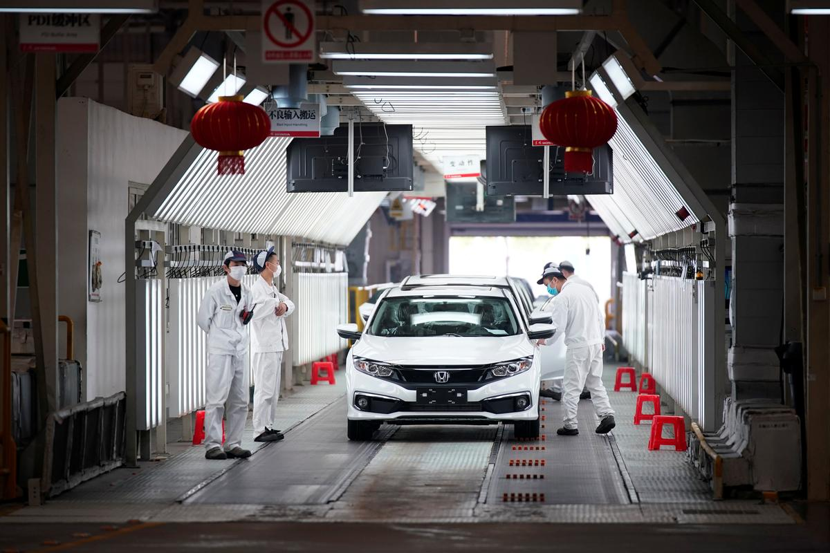Honda back to work in China's Wuhan with temperature checks and masks