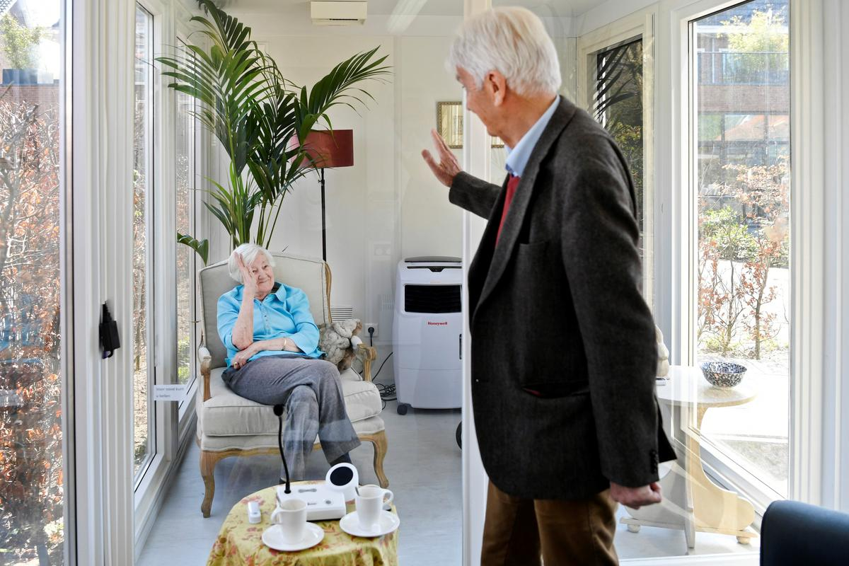 Dutch elderly home builds glass-sided cabin for safe coronavirus visits