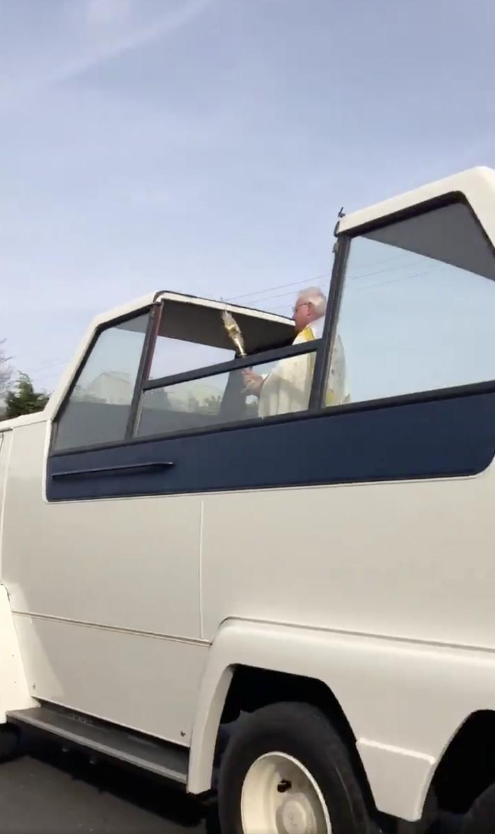 Irish priest spreads coronavirus Easter cheer from vintage 'popemobile'