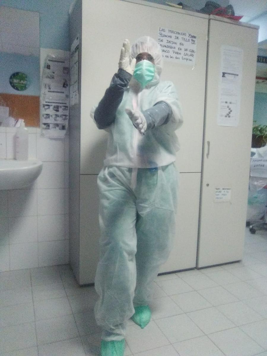 Tired and sick, Spanish nurse ponders coronavirus missteps