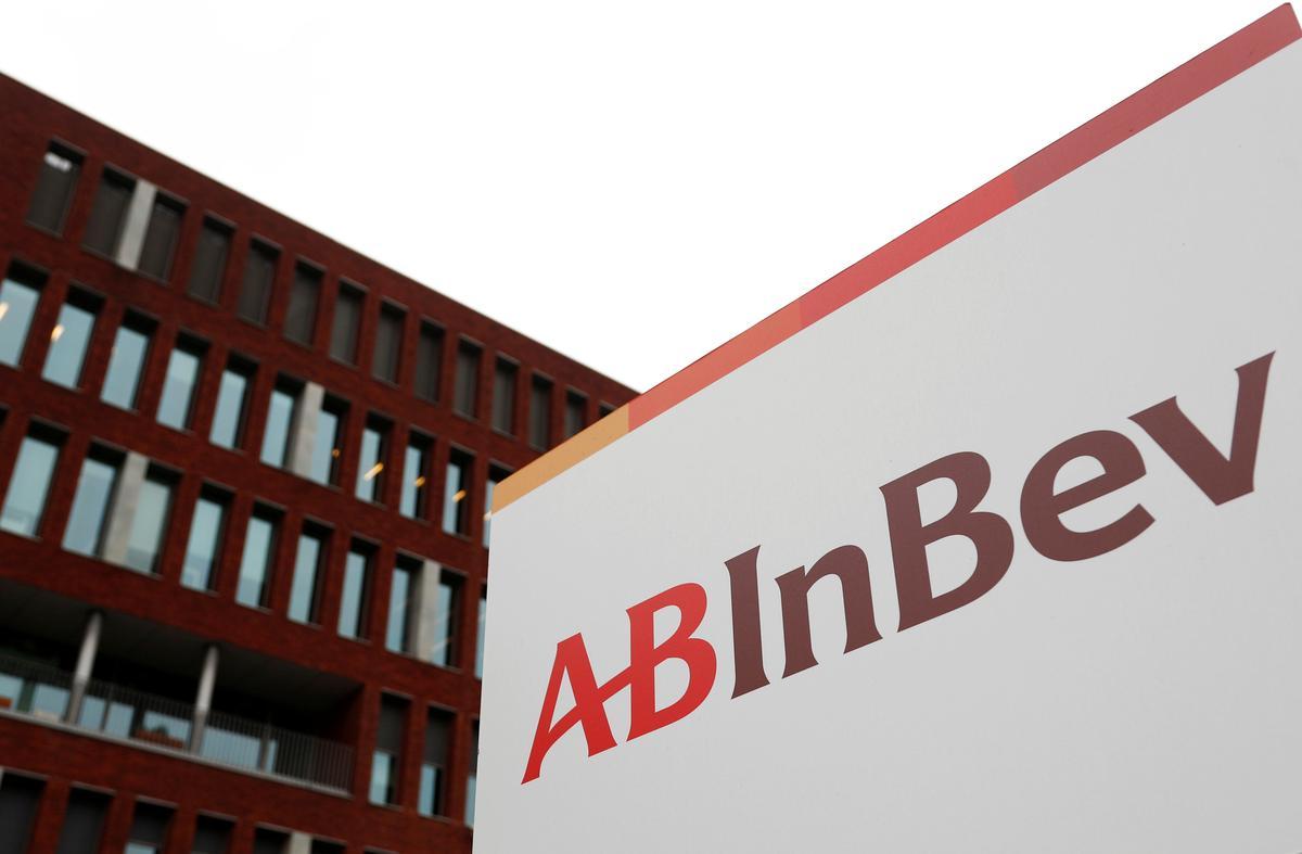 Brewer AB InBev halves final dividend and pushes back AGM