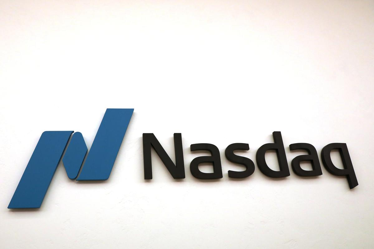Nasdaq cautious as volume spike drives first-quarter profit beat