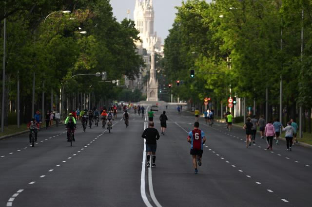 People practice outdoor activities along Paseo de la Castellana avenue after Madrid's local authorities allowed some streets only for pedestrian use during weekends and festivity days amid the coronavirus disease (COVID-19) outbreak in Madrid, Spain, May 9, 2020. REUTERS/Sergio Perez